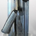 Stibnite-150558CC BY-SA 3.0 Rob Lavinsky / iRocks.com - http://www.mindat.org/photo-150558.html